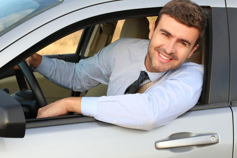 Elegant male driver with a gorgeous smile.  stock photo