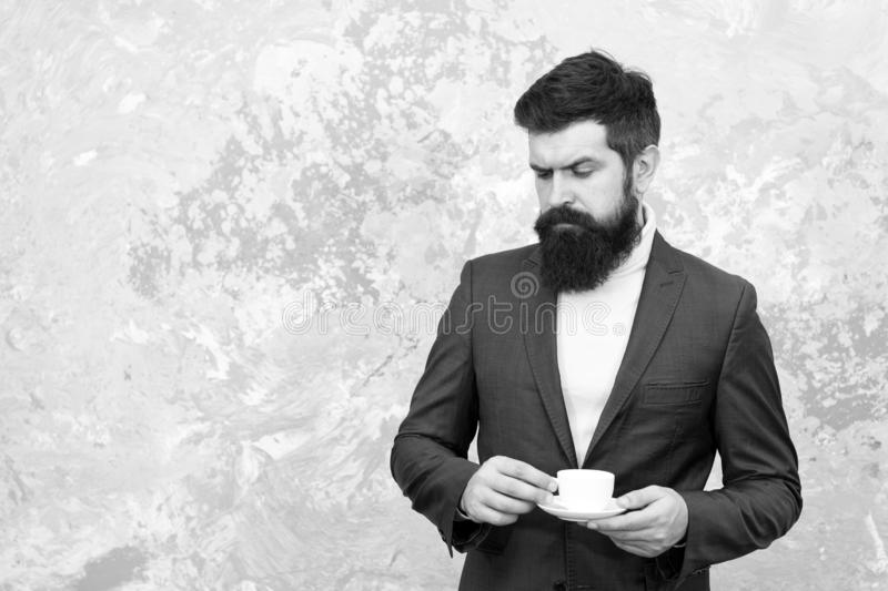 Elegant man with beard drink coffee. Brutal bearded hipster in formal suit. Male fashion model. Mature businessman royalty free stock image