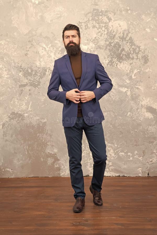 Elegant man with beard. Modern life. Male elegant fashion model. Mature elegant businessman walking. Tailor or fashion royalty free stock photo