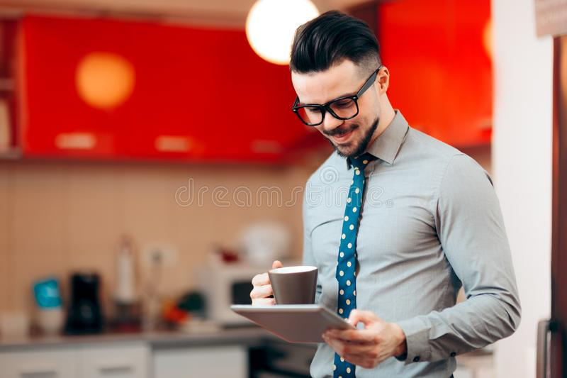 Businessman Having Coffee While Reading the News royalty free stock photo