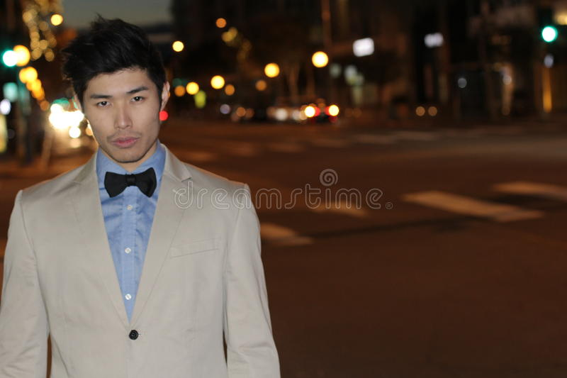Elegant man in the city at night with copy space royalty free stock photo