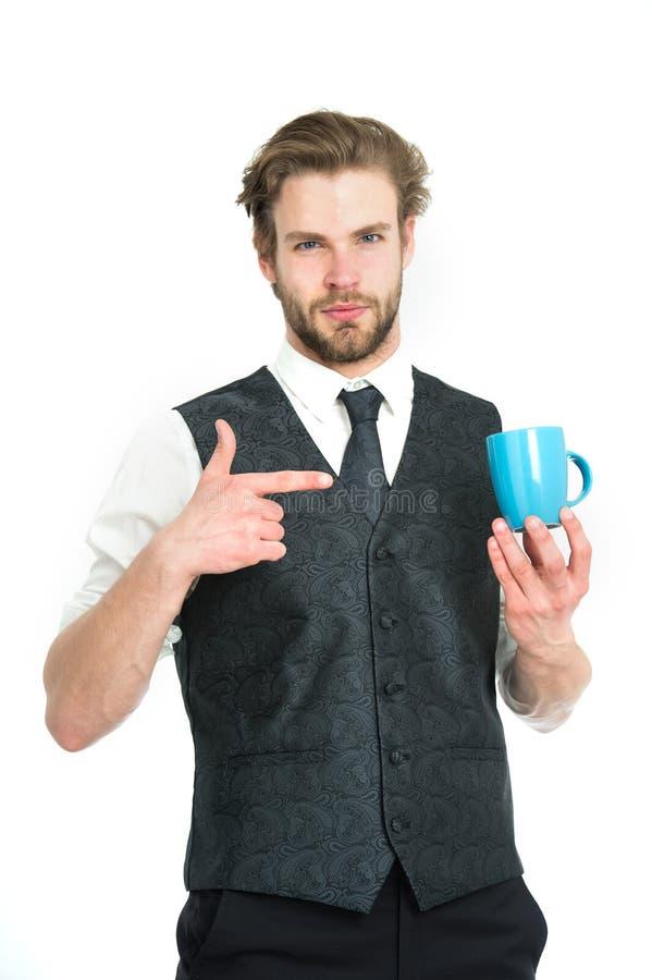 Elegant man i waistcoat med en kopp kaffe arkivbilder
