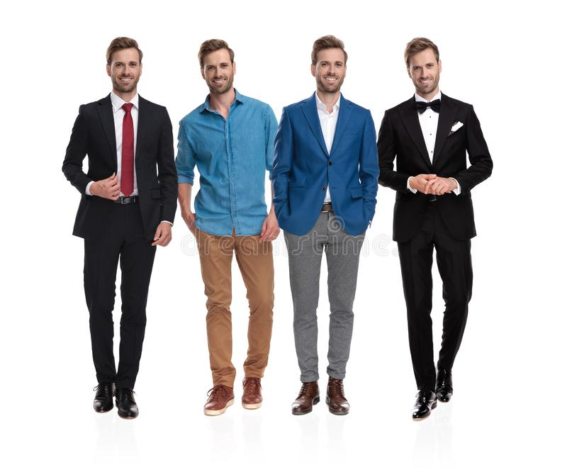 Elegant man posing with four different clothing styles. And positions for a collage image on white studio background royalty free stock images