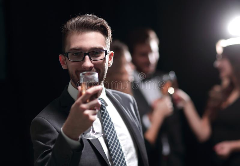 Elegant man raising his glass with the toast stock image