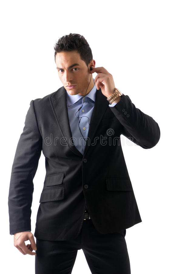 Elegant man ressed as bodyguard or security agent. With earphones, isolated on white royalty free stock photos