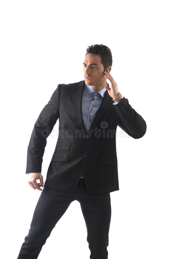 Elegant man ressed as bodyguard or security agent stock image