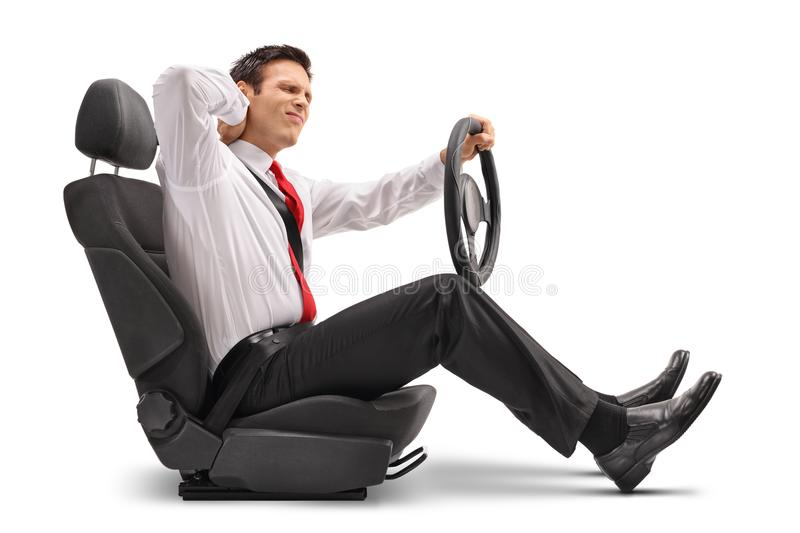 Elegant man seated in a car seat experiencing neck pain. On white background stock image