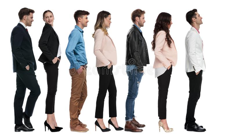 Elegant man standing in line with other people looks up royalty free stock photo