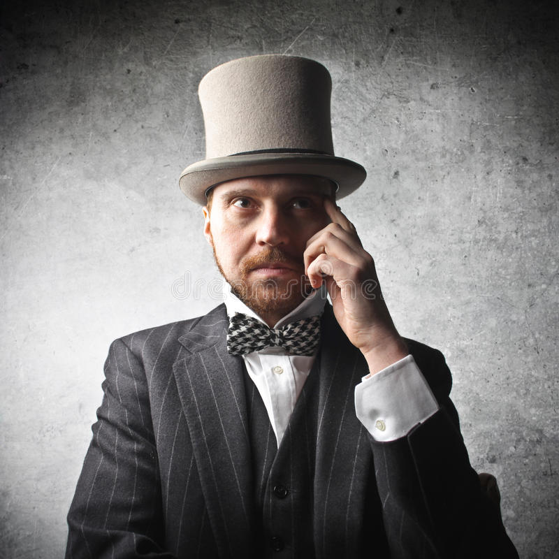 Elegant man. Wearing a top hat stock photo