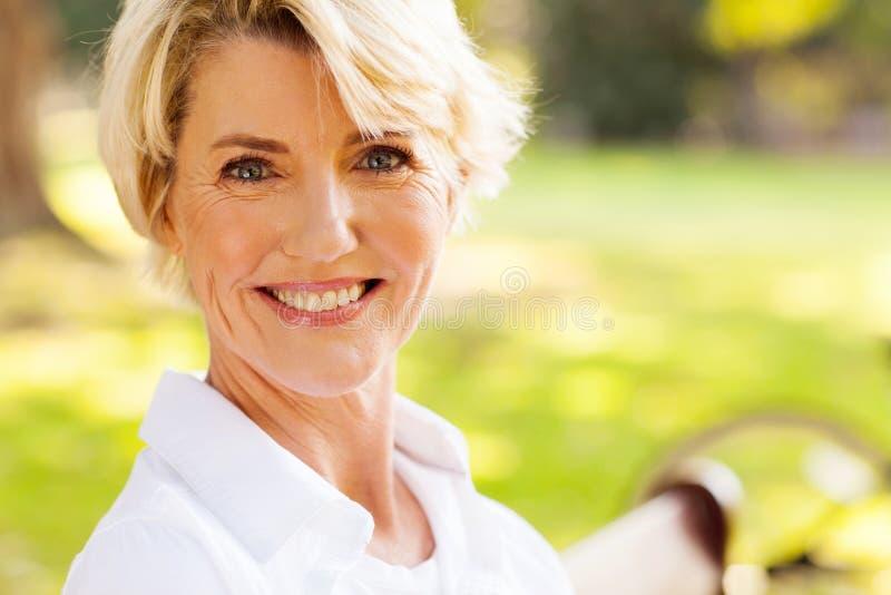 Elegant mature woman stock photo