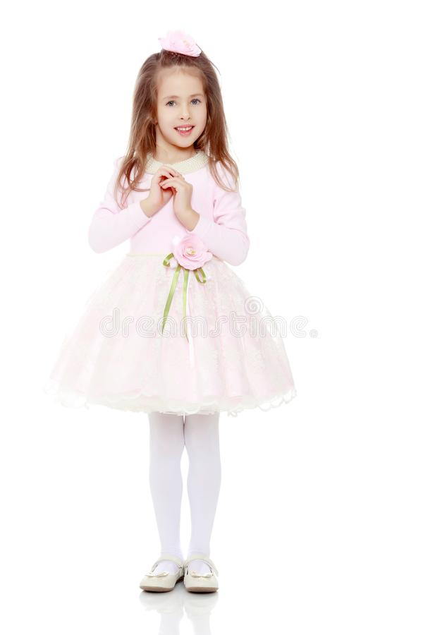 Elegant meisje in een roze kleding royalty-vrije stock afbeeldingen