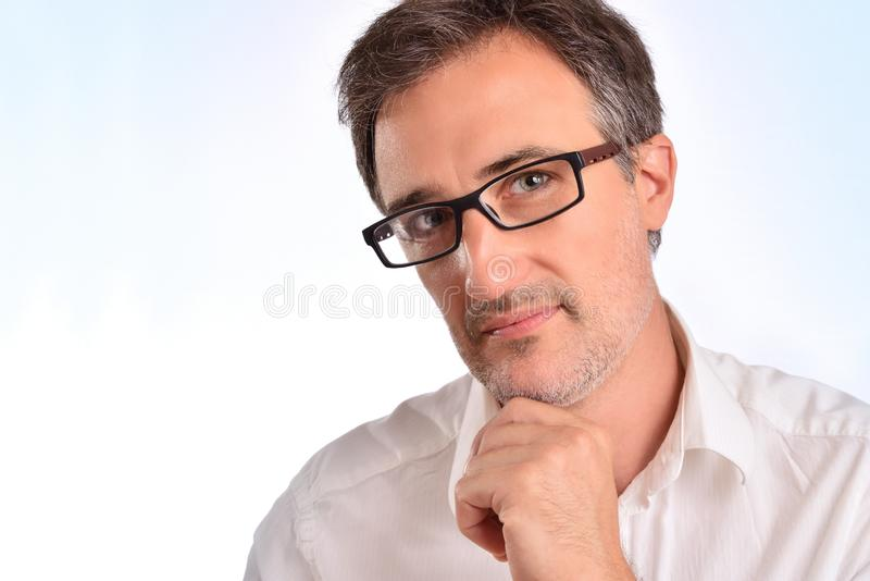 Elegant middle-aged man with glasses and white shirt closeup stock images