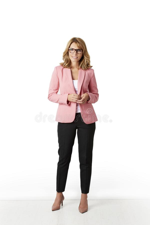 Elegant middle aged woman full length portrait at isolated background stock image