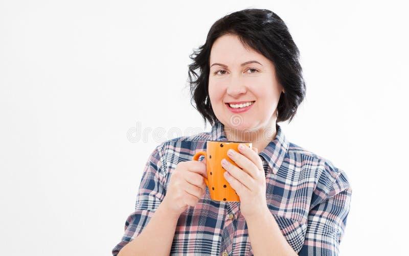 Elegant middle brunette holds tasty drink on white background royalty free stock images
