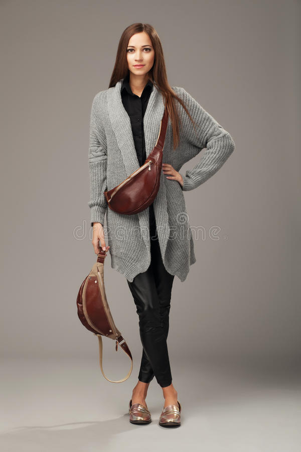 Free Elegant Model In Gray Woven Cardigan With Two Leather Fanny Pack Royalty Free Stock Image - 67638346