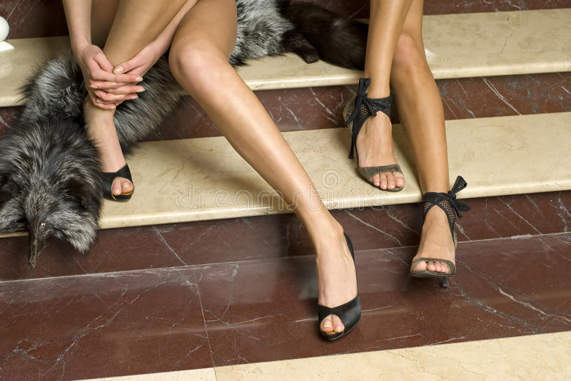 Elegant models legs with fashion shoes royalty free stock photography