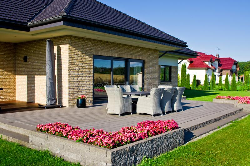 Elegant home terrace with garden furniture royalty free stock images