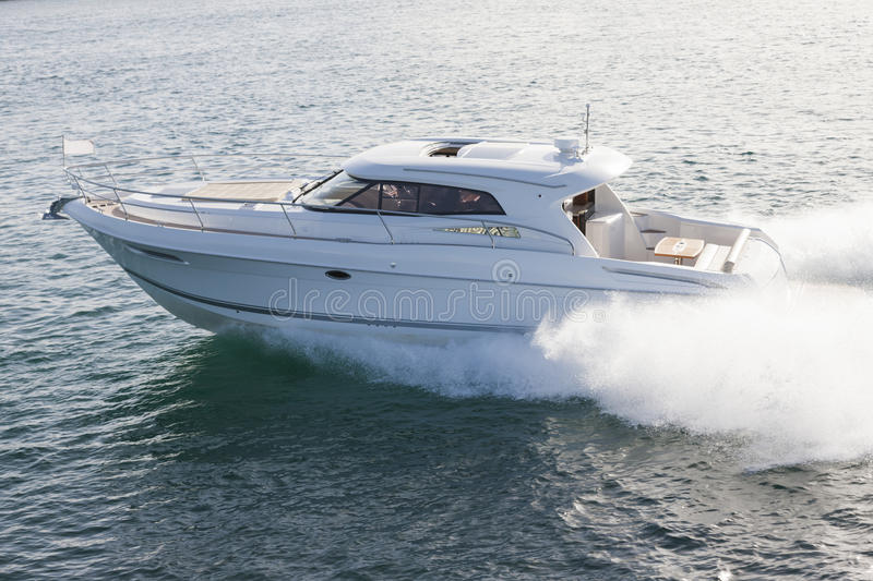 Elegant motor boat sailing at high speed. On a sunny day royalty free stock photo