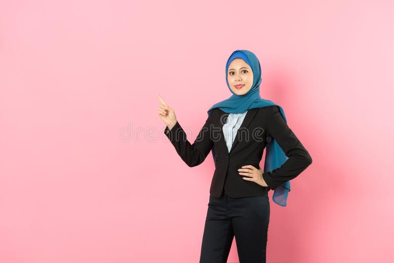 Elegant muslim business woman pointing empty area royalty free stock image