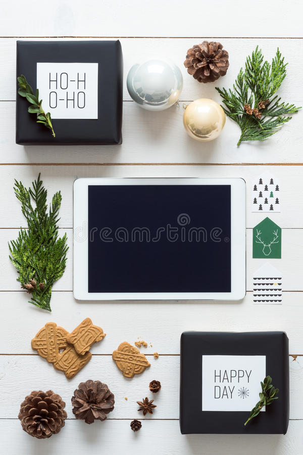 Elegant nordic retro christmas, wrapping station, desk view from above, online shopping royalty free stock images