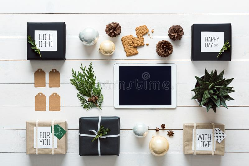 Elegant nordic retro christmas, wrapping station, desk view from above, online shopping stock photo