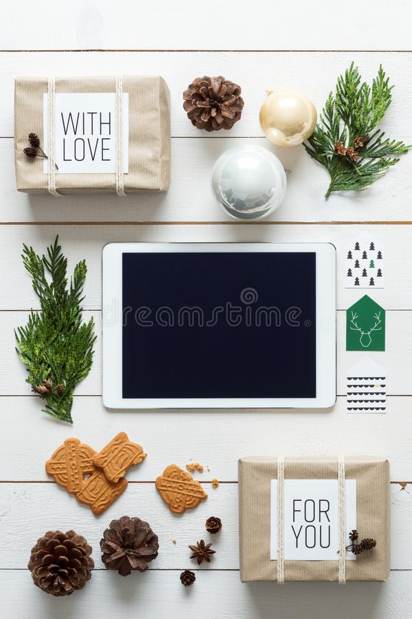 Elegant nordic retro christmas, wrapping station, desk view from above, online shopping royalty free stock image