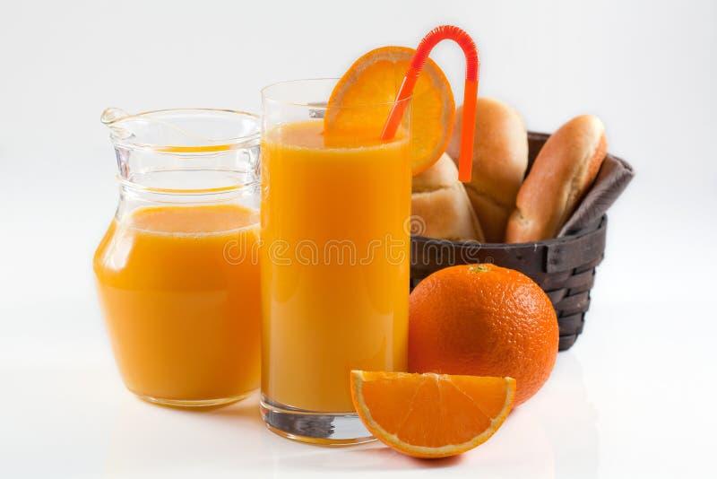 Elegant orange juice breakfast. Luxorious breakfast with sweet bread and orange juice on white background stock photo