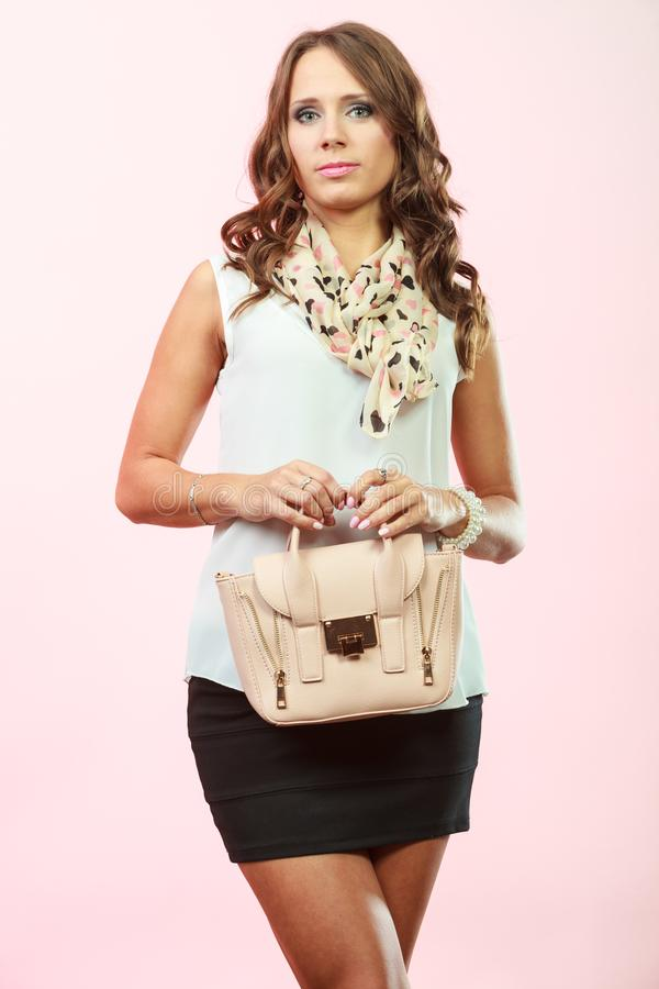 Fashionable girl holding bag handbag royalty free stock photos