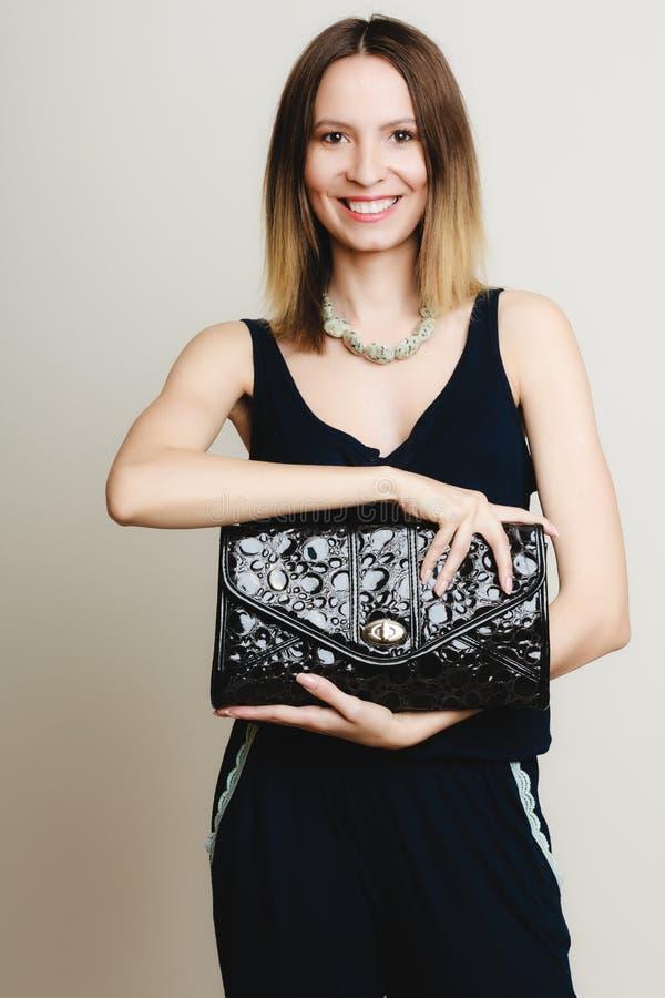 Free Elegant Outfit. Stylish Woman With Black Handbag Royalty Free Stock Images - 41257859