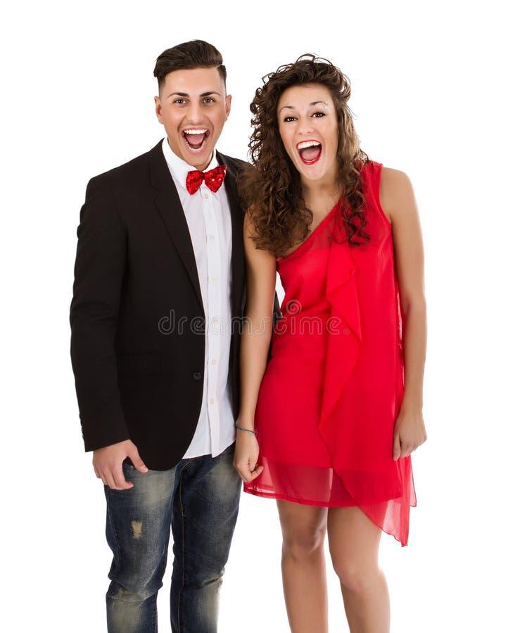 Elegant paar in wit geluk als achtergrond stock afbeeldingen