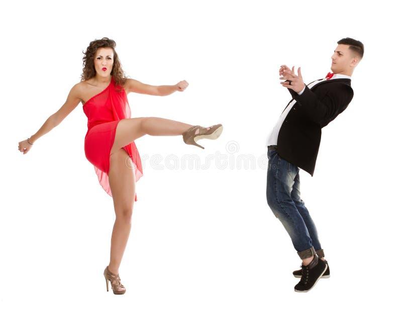 Elegant paar in witte strijd als achtergrond royalty-vrije stock afbeelding