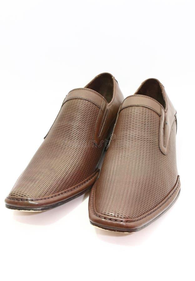 Elegant pair of brown shoes royalty free stock image