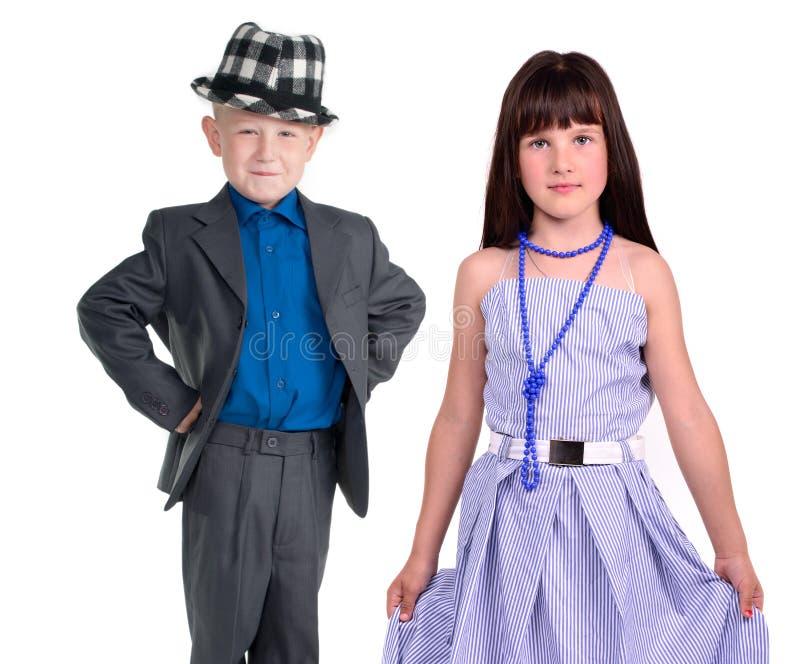 Elegant pair - little girl and boy royalty free stock photo