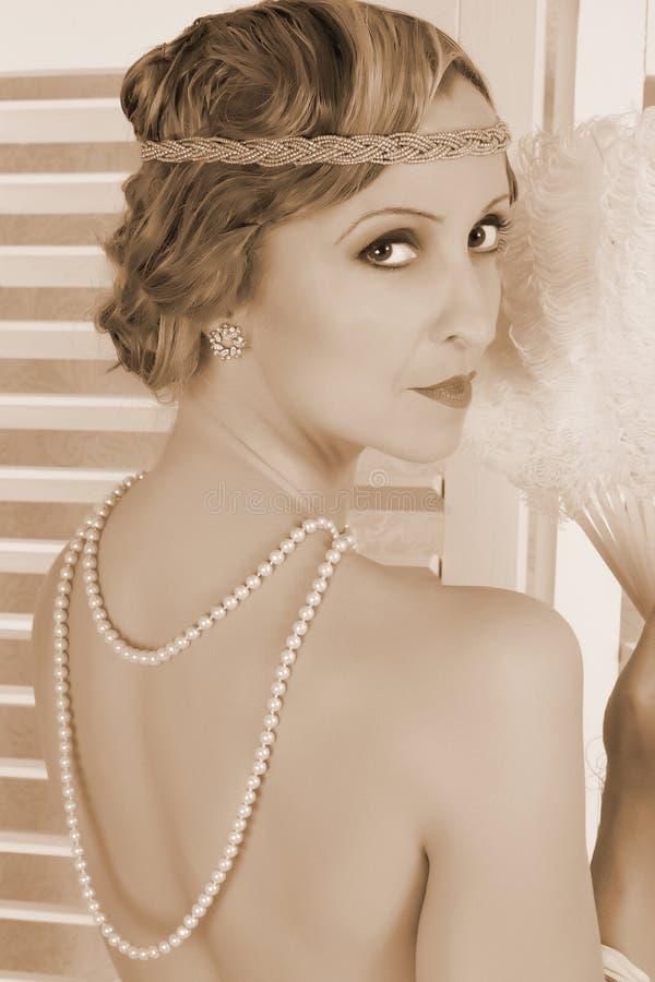 Elegant pearls on nude lady royalty free stock photo