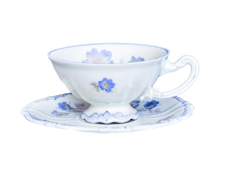 Elegant porcelain tea cup on saucer isolated on white background. Vintage antique elegant porcelain tea cup on saucer isolated on a white background isolated royalty free stock photo