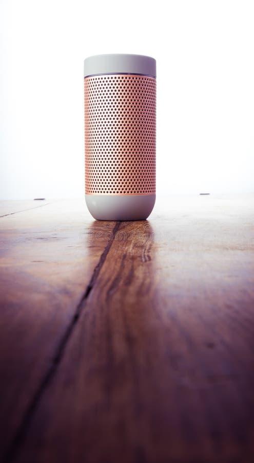 Elegant portable bluetooth speaker isolated on wooden background. Music stock photo