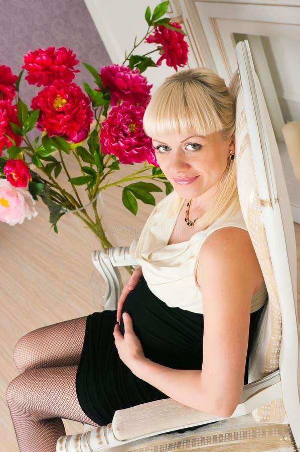 Elegant pregnant woman stock images