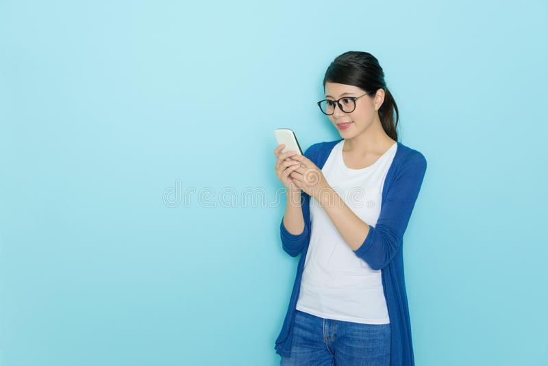 Elegant pretty woman using mobile smartphone royalty free stock photography