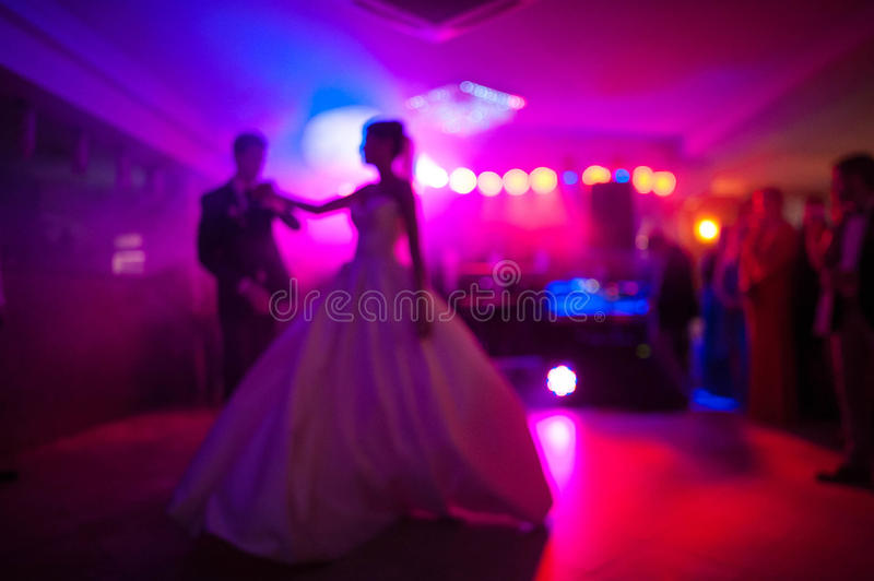 Elegant pretty young bride and groom dance royalty free stock photography