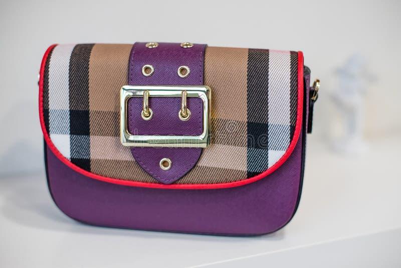 Elegant purple Women`s handbag, Ladies bag, trendy female clutch with plaid pattern.Women`s bag isolated white. Yellow Women`s handbag, Ladies bag, Yellow female royalty free stock photography
