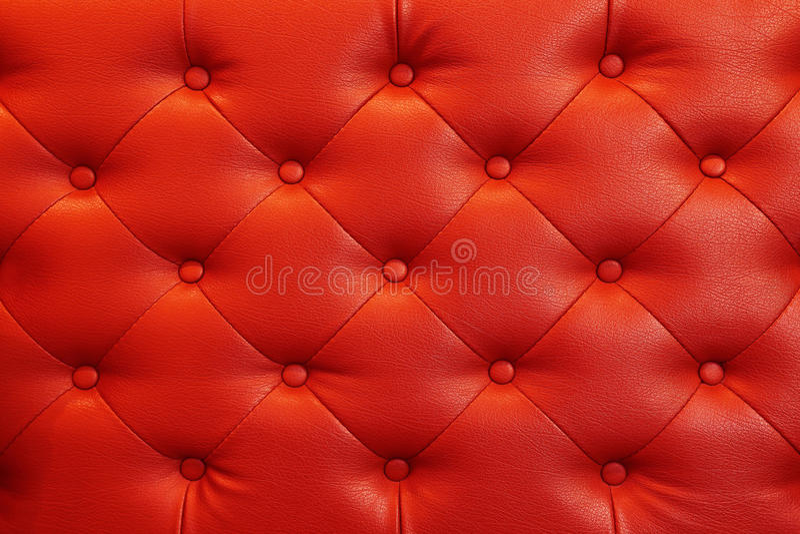 elegant röd lädertextur med knappar för bakgrund och desi royaltyfria bilder