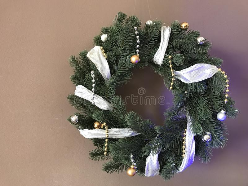 Elegant real Christmas wreath with ribbon royalty free stock photography