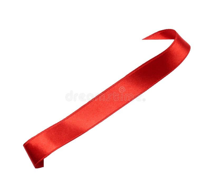 Elegant red satin ribbon. On white background royalty free stock photography