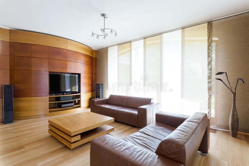 Elegant room with home cinema system royalty free stock photography