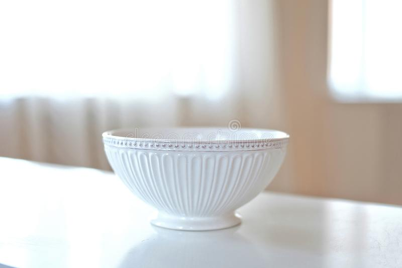 Elegant saucer on a table in large bright room royalty free stock images