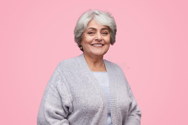 Elegant senior female looking at camera stock image