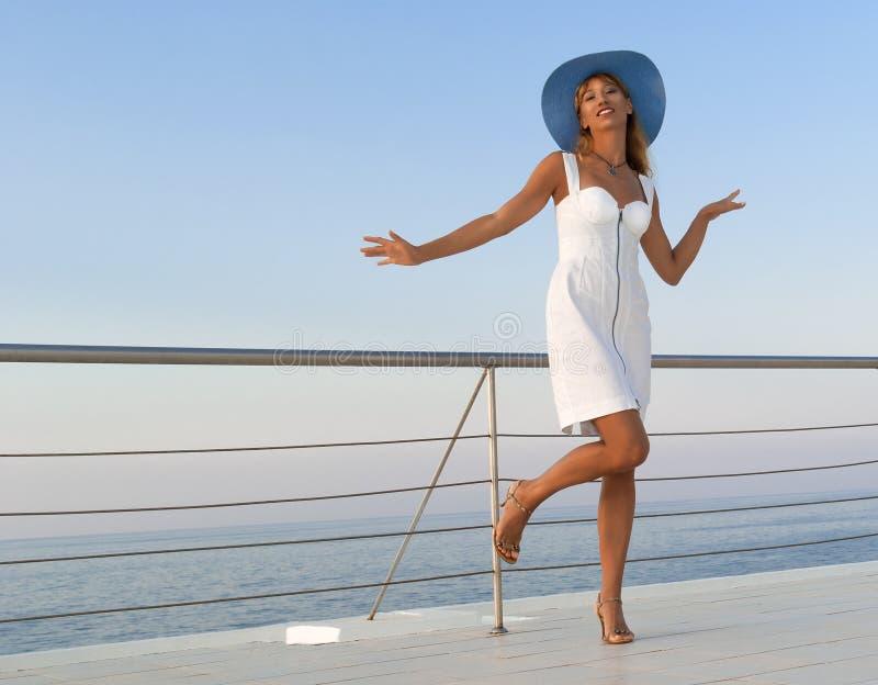 Elegant woman in white dress dancing stock photography