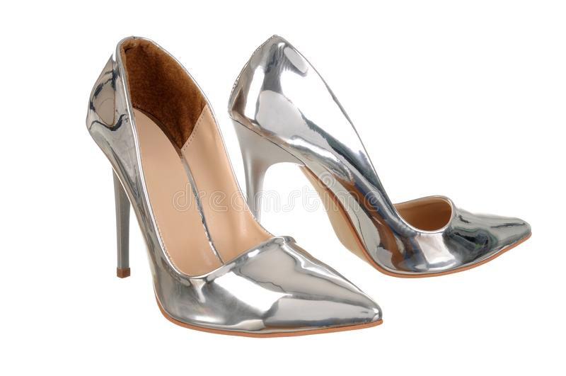 Silver high heel women shoes. Elegant silver high heel women shoes isolated on white. Fashion, lifestyle, shopping royalty free stock images
