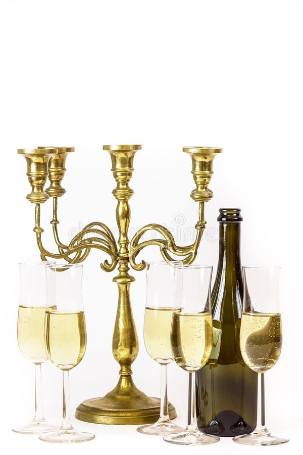 Elegant, simple image. Glasses of champagne and candelabra. stock photo