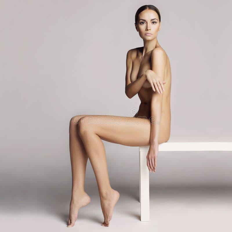 Elegant sitting lady stock photos